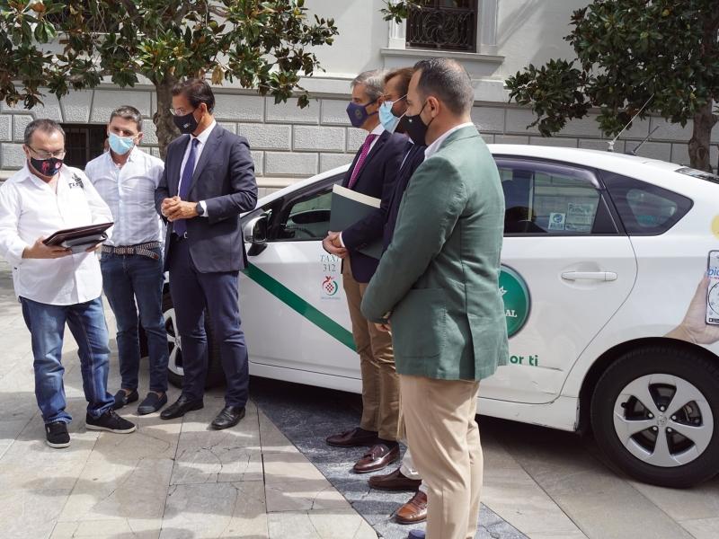 Firma convenio taxi